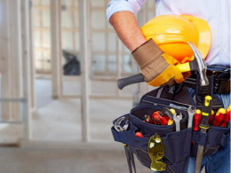 Man with tool belt and hard hat