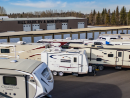 Row of drive-up storage units and parking lot with RVs