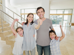 Family holding keys to new home