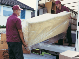 Professional Movers Moving Furniture