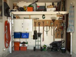 Garage with shelving & wall mounted items