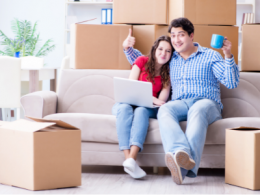 Couple Packing Boxes For A Move