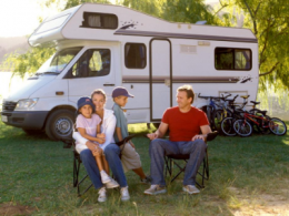 Family sitting in front of motorhome