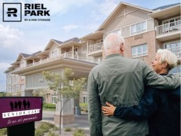 Couple with arms around each other in front of Senior Care Facility