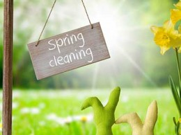 Grass and flower with spring cleaning sign