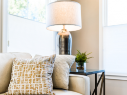 Staged Living Room With Couch and Lamp