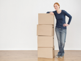 Lady standing beside stacked boxes
