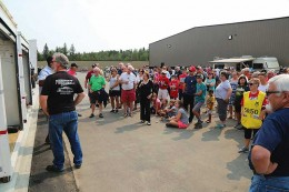 Crowd gather in front of Storage Unit