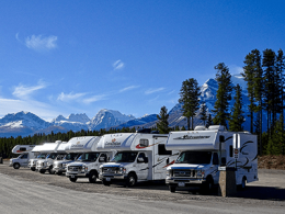 RVs parked with mountains in the background